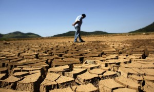 A utility worker looks at the cracked ground of Jaguary dam in Braganca Paulista